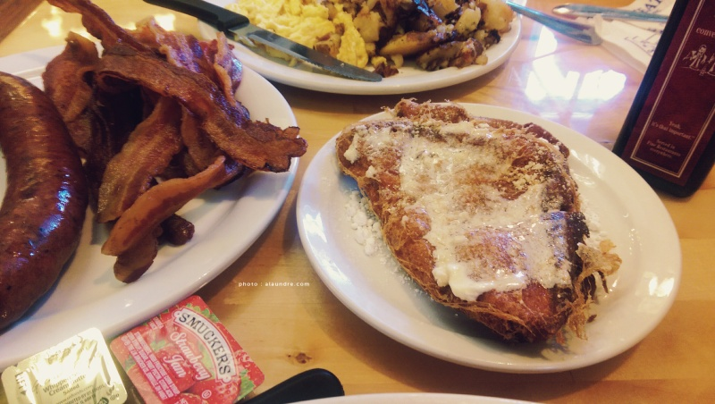 French Toast, Three Egg Omelette with a side order of Sausage and Bacon